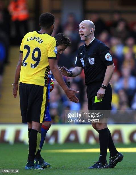 Referee Anthony Taylor speaks with Watford's Etienne Capoue