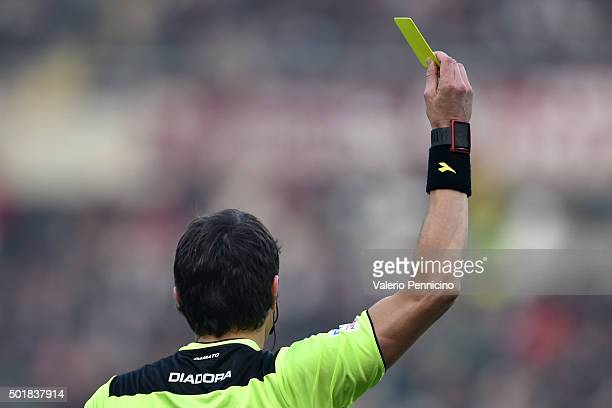 Referee Antonio Damato shows a yellow card during the Serie A match between Torino FC and AS Roma at Stadio Olimpico di Torino on December 5 2015 in...