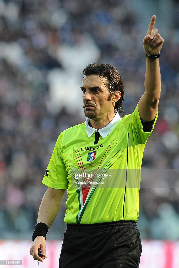 Referee Antonio Giannoccaro signals a foul during the Serie A match between FC Juventus and Calcio Catania at Juventus Arena on March 10, 2013 in Turin, Italy.