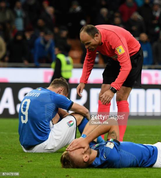 Referee Antonio Mateu Lahoz and Andrea Belotti of Italy of Italy chat at the end of the FIFA 2018 World Cup Qualifier PlayOff Second Leg between...
