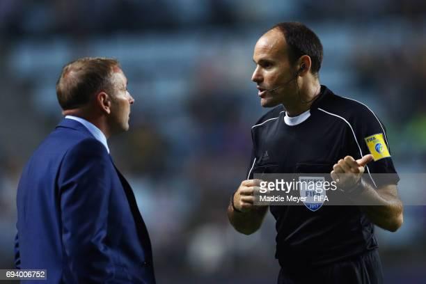 Referee Antonio Mateu Lahoz speaks with head coach Paul Simpson of England during the FIFA U20 World Cup Korea Republic 2017 Semi Final match between...