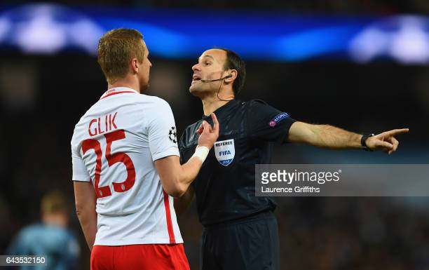 Referee Antonio Miguel Mateu Lahoz in discussion with Kamil Glik of AS Monaco during the UEFA Champions League Round of 16 first leg match between...