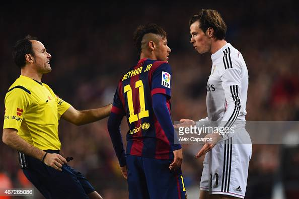Referee Antonio Miguel Mateu Lahoz intervenes as Neymar of Barcelona and Gareth Bale of Real Madrid CF clash during the La Liga match between FC...