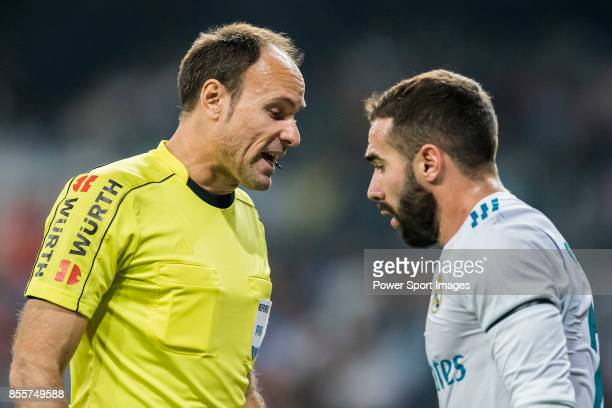 Referee Antonio Miguel Mateu Lahoz talks to Daniel Carvajal Ramos of Real Madrid during the La Liga 201718 match between Real Madrid and Real Betis...