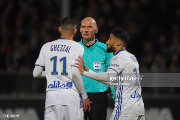 Referee Antony Gautier and Rachid Ghezzal of Lyon and Nabil Fekir of Lyon during the French Ligue 1 match between Angers and Lyon on April 28 2017 in...