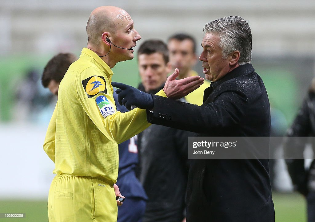 Referee Antony Gautier argues with Carlo Ancelotti, coach of PSG during the Ligue 1 match between AS Saint-Etienne ASSE and Paris Saint-Germain FC at the Stade Geoffroy-Guichard on March 17, 2013 in Saint-Etienne, France.