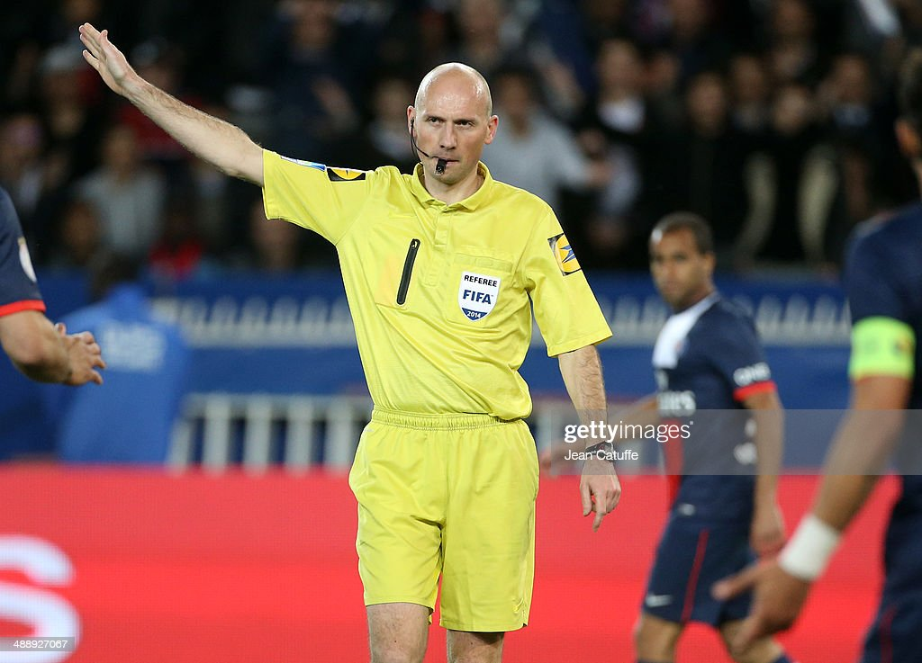 Referee Antony Gautier in action during the french Ligue 1 match between Paris Saint-Germain FC and Stade Rennais FC at Parc des Princes stadium on May 7, 2014 in Paris, France.