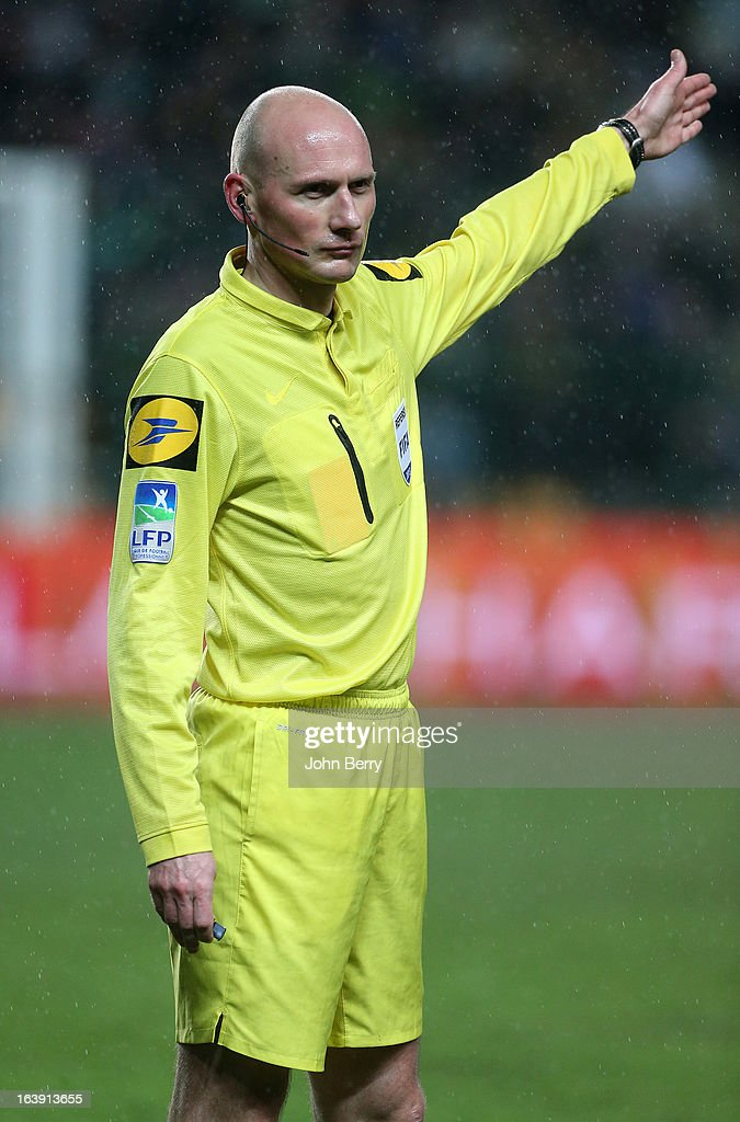 Referee Antony Gautier in action during the Ligue 1 match between AS Saint-Etienne ASSE and Paris Saint-Germain FC at the Stade Geoffroy-Guichard on March 17, 2013 in Saint-Etienne, France.