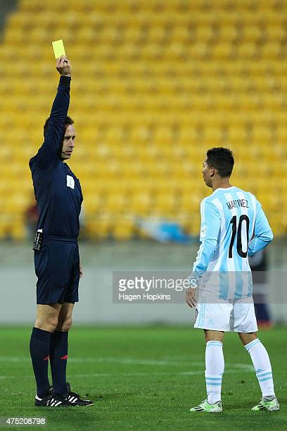 Referee Artur Soares Dias of Portugal shows Tomas Martinez of Argentina a yellow card during the Group B FIFA U20 World Cup New Zealand 2015 match...