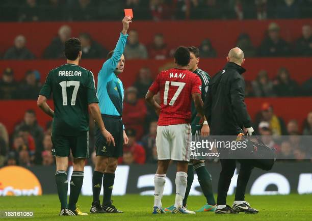 Referee Bahattin Duran sends off Nani of Manchester United during the UEFA Champions League Round of 16 Second leg match between Manchester United...