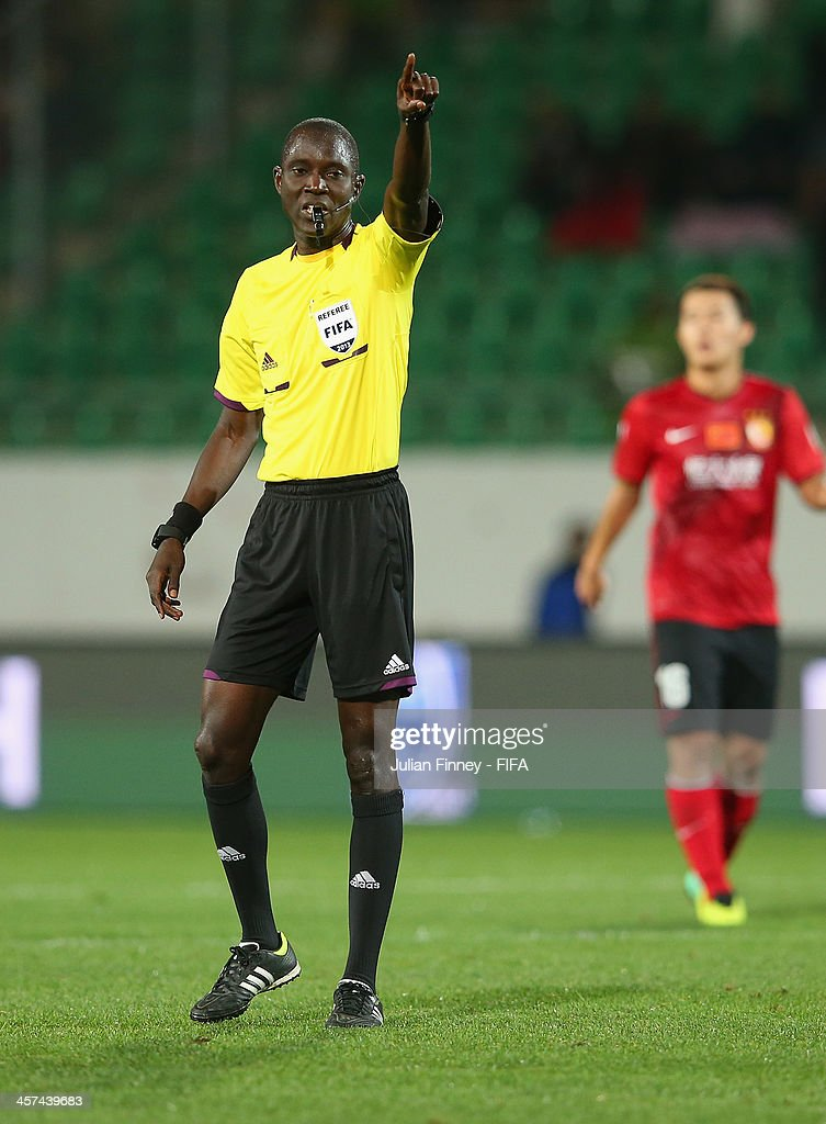 Referee, Bakary Gassama makes a decision during the FIFA Club World Cup Semi Final match between Guangzhou Evergrande FC and Bayern Muenchen at the Agadir Stadium on December 17, 2013 in Agadir, Morocco.