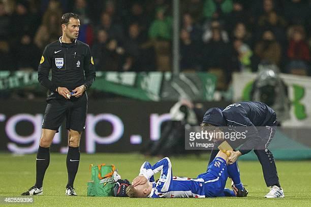 referee Bas Nijhuis Daley Sinkgraven of sc Heerenveen physiotherapist Erik ten Voorde of sc Heerenveen during the Dutch Eredivisie match between FC...