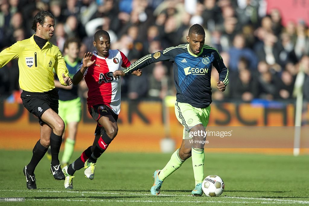 referee Bas Nijhuis, Miquel Nelom of Feyenoord, Ryan Babel of Ajax during the Dutch Eredivisie match between Feyenoord and Ajax Amsterdam at De Kuip on October 28, 2012 in Rotterdam, The Netherlands.