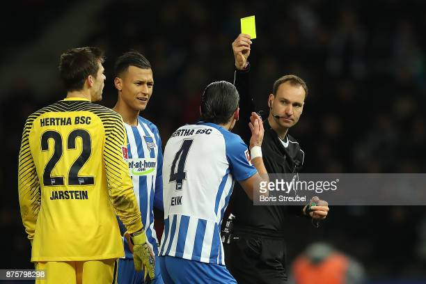 Referee Bastian Dankert awards Moenchengladbach a penalty following video referee check and shows Karim Rekik of Berlin a yellow card fo a hand ball...