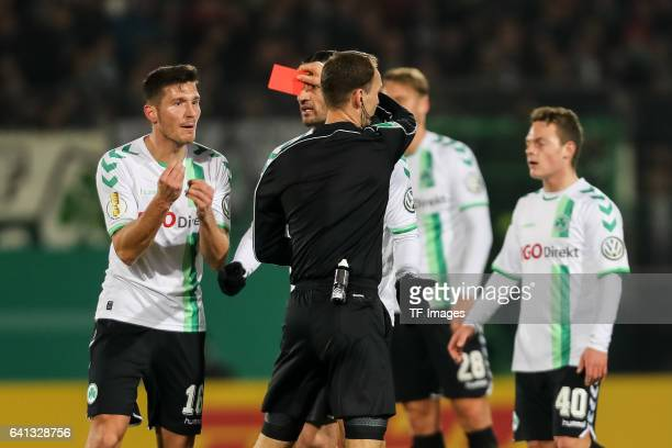 Referee Bastian Dankert gievs Adam Pinter of Greuther Fuerth the red card during the DFB Cup match between SpVgg Greuther Fuerth and Borussia...