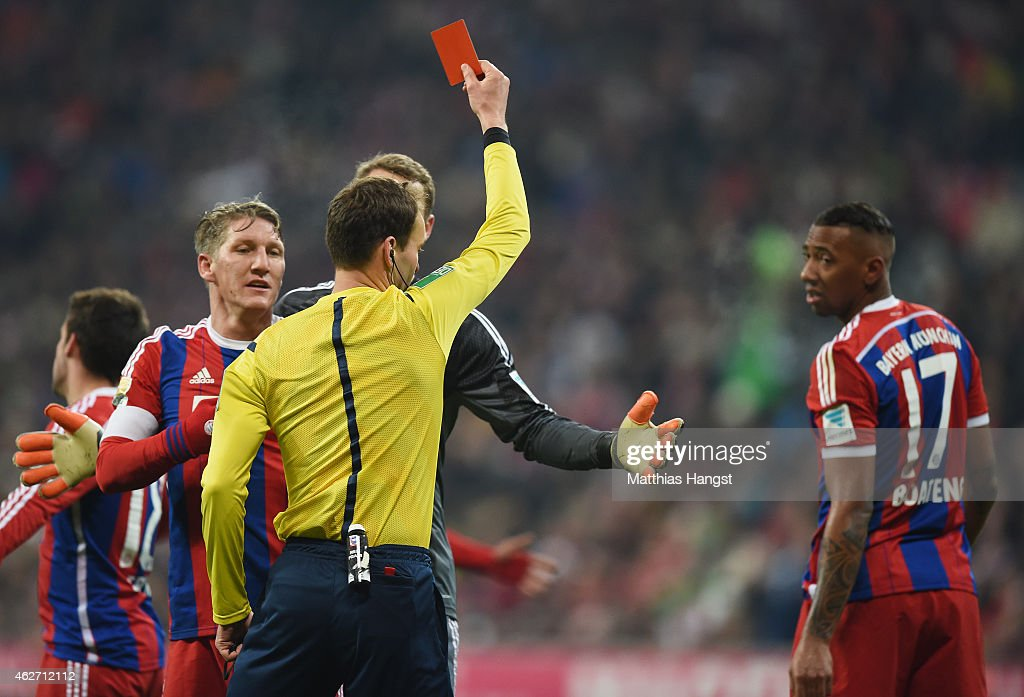 Referee Bastian Dankert shows the red card to <a gi-track='captionPersonalityLinkClicked' href=/galleries/search?phrase=Jerome+Boateng&family=editorial&specificpeople=2192287 ng-click='$event.stopPropagation()'>Jerome Boateng</a> (R) of Muenchen during the Bundesliga match between FC Bayern Muenchen and FC Schalke 04 at Allianz Arena on February 3, 2015 in Munich, Germany.