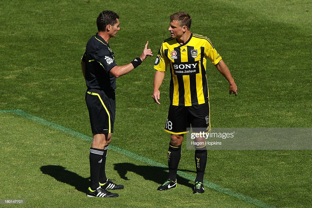 Referee Ben Williams gives Ben Sigmund of the Phoenix a warning during the round 18 A-League match between the Wellington Phoenix and the Newcastle Jets at Westpac Stadium on January 27, 2013 in Wellington, New Zealand.