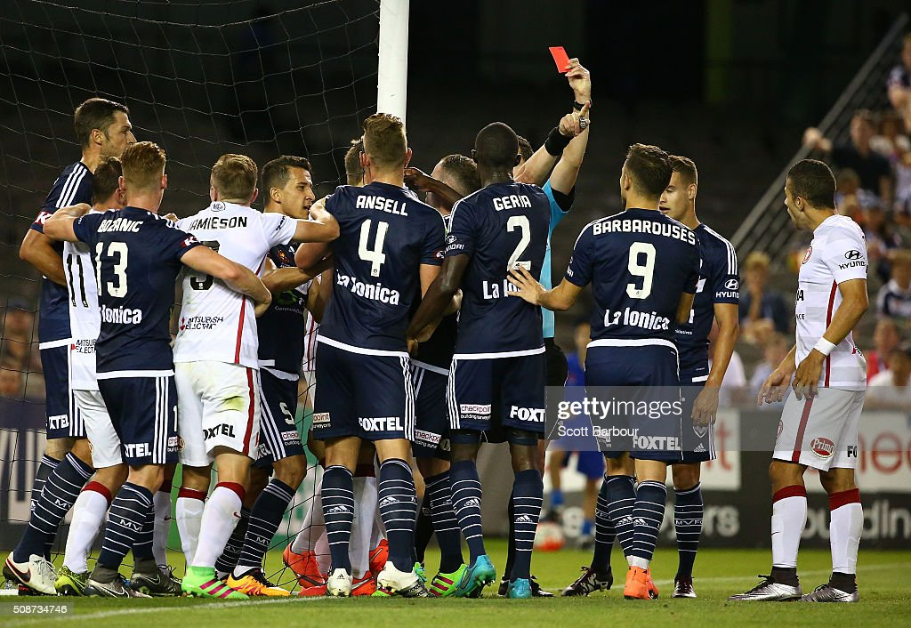 Referee Ben Williams shows a red card to Alberto Aguilar of the Wanderers during the round 18 A-League match between the Melbourne Victory and Western Sydney Wanderers at Etihad Stadium on February 6, 2016 in Melbourne, Australia.