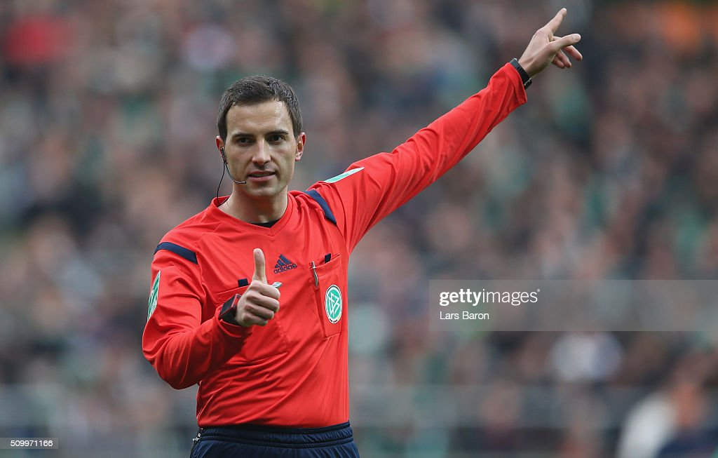 Referee Benjamin Brand gestures during the Bundesliga match between Werder Bremen and 1899 Hoffenheim at Weserstadion on February 13, 2016 in Bremen, Germany.
