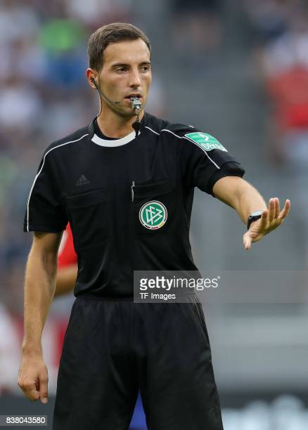 Referee Benjamin Brand gestures during the first Audi Cup football match between Atletico Madrid and SSC Napoli in the stadium in Munich southern...