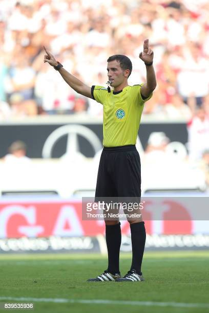 Referee Benjamin Brand gestures the signal of the video assistant during the Bundesliga match between VfB Stuttgart and 1 FSV Mainz 05 at...