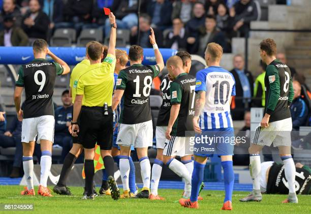 referee Benjamin Brand shows Genki Haraguchi of Hertha BSC the red card during the game between Hertha BSC and Schalke 04 on october 14 2017 in...