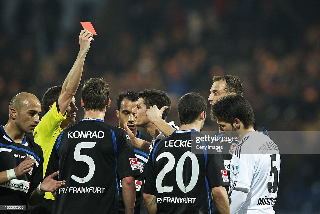 Referee Benjamin Brand (L) shows the red card to Juergen Moessmer of Aalen (R) during the Second Bundesliga match between FSV Frankfurt and VfR Aalen at Frankfurter Volksbank Stadium on March 8, 2013 in Frankfurt am Main, Germany.