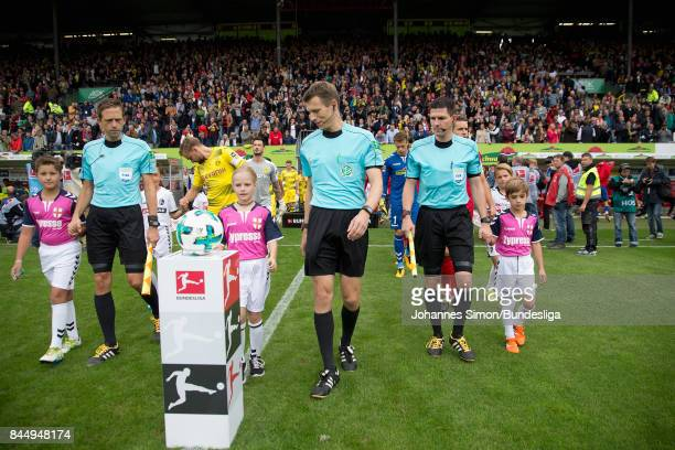 Referee Benjamin Cortus and assistants Mark Borsch and Stefan Lupp arrive for the Bundesliga match between SportClub Freiburg and Borussia Dortmund...