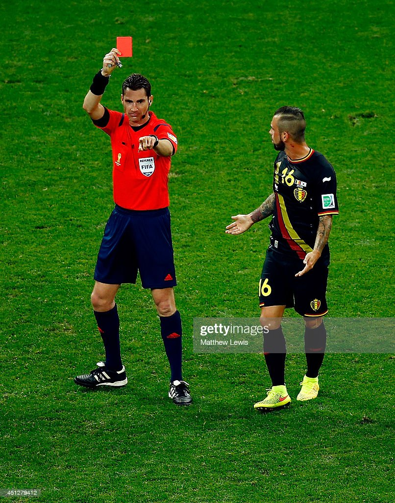 Referee Benjamin Williams shows a red card to <a gi-track='captionPersonalityLinkClicked' href=/galleries/search?phrase=Steven+Defour&family=editorial&specificpeople=5733692 ng-click='$event.stopPropagation()'>Steven Defour</a> of Belgium during the 2014 FIFA World Cup Brazil Group H match between South Korea and Belgium at Arena de Sao Paulo on June 26, 2014 in Sao Paulo, Brazil.