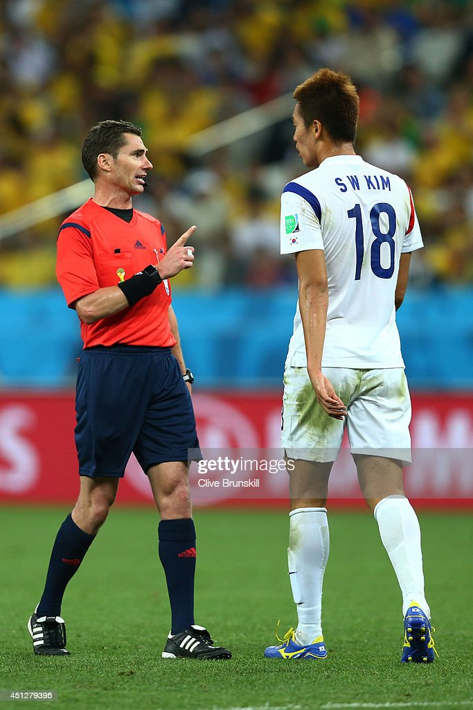 Referee Benjamin Williams speaks to Kim Shin-Wook of South Korea during the 2014 FIFA World Cup Brazil Group H match between South Korea and Belgium at Arena de Sao Paulo on June 26, 2014 in Sao Paulo, Brazil.