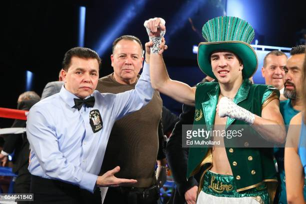 Referee Benjy Esteves raises the arm of Michael Conlan after his 3rd round TKO win over Tim Ibarra in their super bantamweight bout at The Theater at...