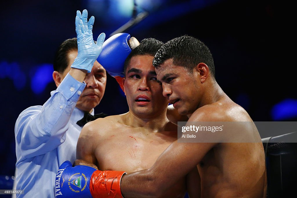 Referee Benjy Estevez stops the fight in the ninth round and declares a TKO for Roman Gonzalez against <a gi-track='captionPersonalityLinkClicked' href=/galleries/search?phrase=Brian+Viloria&family=editorial&specificpeople=850361 ng-click='$event.stopPropagation()'>Brian Viloria</a> during their WBC Flyweight Title fight at Madison Square Garden on October 17, 2015 in New York City.