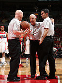 NBA referee Bennett Salvatore discuss a play with Joe Crawford and Zach Zarba during the game between the Atlanta Hawks and Washington Wizards in...