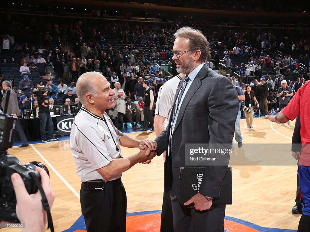 Referee Bennett Salvatore shakes hands with New York Knicks assistant coach Kurt Rambis before the game against the Detroit Pistons on April 15 2015...