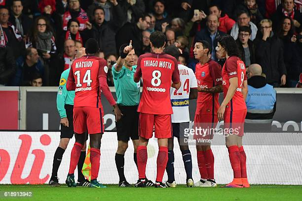 Referee Benoit Bastien disallows a goal by Angel Di Maria of PSG for handball after consulting with his assistant during the French Ligue 1 match...