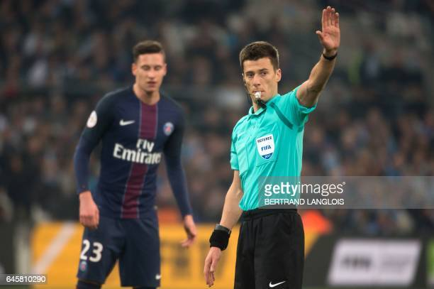 Referee Benoit Bastien gestures during the French L1 football match Olympique de Marseille vs Paris SaintGermain on February 26 2017 at the Velodrome...
