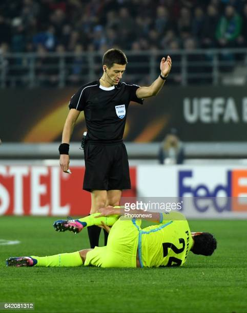 referee Benoit Bastien gestures pictured during the UEFA Europa League Round of 32 First Leg between KAA Gent and Tottenham Hotspur on february 16...