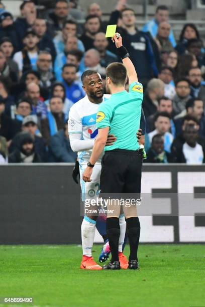 Referee Benoit Bastien gives Patrice Evra of Marseille a yellow card during the French Ligue 1 match Marseille and Paris Saint Germain at Stade...
