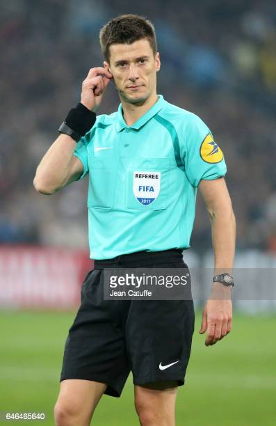 Referee Benoit Bastien looks on during the French Ligue 1 match between Olympique de Marseille and Paris Saint Germain at Stade Velodrome on February...