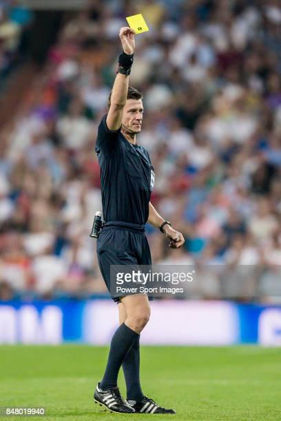 Referee Benoit Bastien shows Roland Sallai of APOEL FC the yellow card during the UEFA Champions League 201718 match between Real Madrid and APOEL FC...