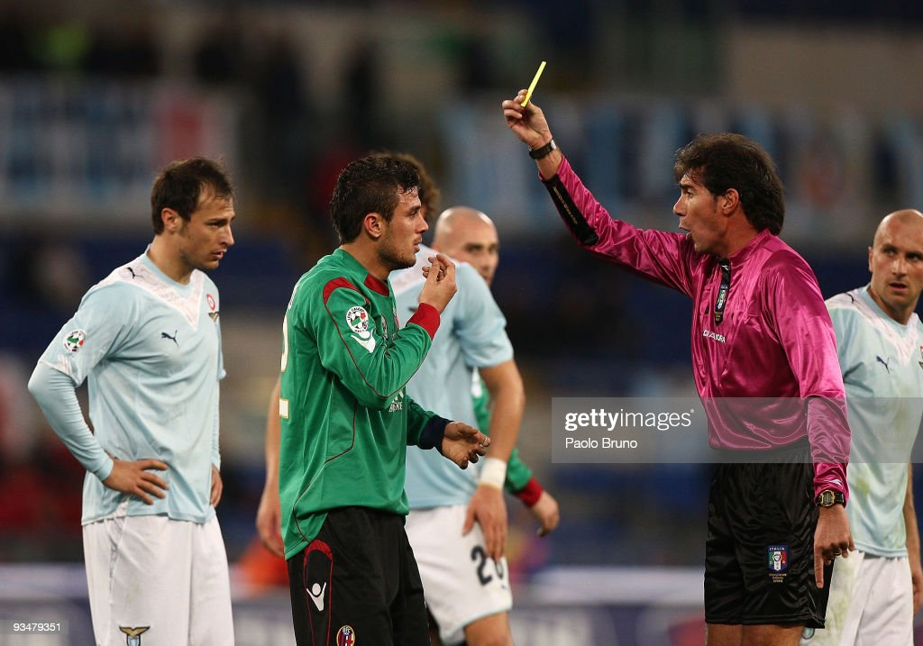 Referee Bergonzoni (R) shows the yellow card to <a gi-track='captionPersonalityLinkClicked' href=/galleries/search?phrase=Stefan+Radu&family=editorial&specificpeople=4050253 ng-click='$event.stopPropagation()'>Stefan Radu</a> (L) of SS Lazio and to <a gi-track='captionPersonalityLinkClicked' href=/galleries/search?phrase=Pablo+Daniel+Osvaldo&family=editorial&specificpeople=4607628 ng-click='$event.stopPropagation()'>Pablo Daniel Osvaldo</a> (C) of Bologna during the Serie A match between SS Lazio and Bologna FC at Stadio Olimpico on November 29, 2009 in Rome, Italy.