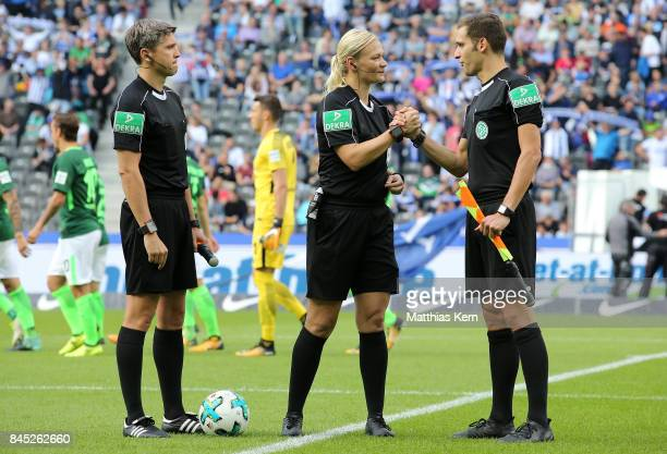 Referee Bibiana Steinhaus and her referee mates Christof Guensch and Thomas Stein look on during the Bundesliga match between Hertha BSC and SV...