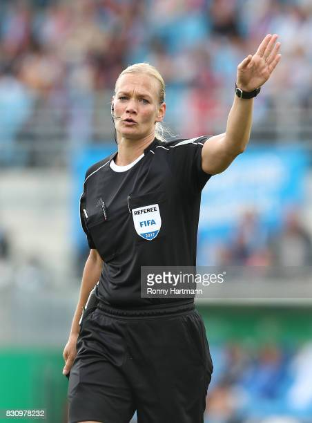 Referee Bibiana Steinhaus gestures during the DFB Cup first round match between Chemnitzer FC and FC Bayern Muenchen at community4you Arena on August...