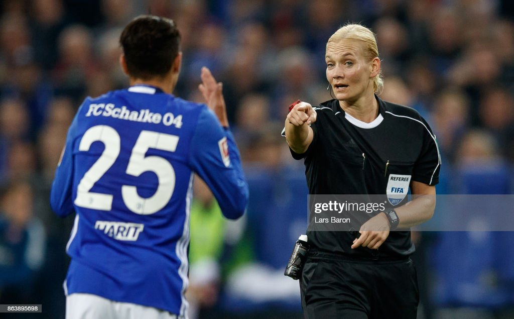 Referee Bibiana Steinhaus gives instructions to Amine Harit of Schalke during the Bundesliga match between FC Schalke 04 and 1. FSV Mainz 05 at Veltins-Arena on October 20, 2017 in Gelsenkirchen, Germany.