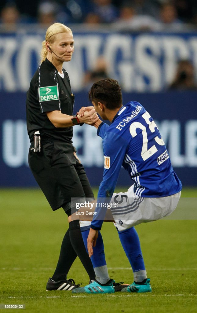 Referee Bibiana Steinhaus helps Amine Harit of Schalke during the Bundesliga match between FC Schalke 04 and 1. FSV Mainz 05 at Veltins-Arena on October 20, 2017 in Gelsenkirchen, Germany.