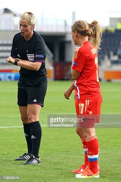 Referee Bibiana Steinhaus of Germany issues instructions to Natalia Shlyapina of Russia during the UEFA Women's EURO 2013 Group C match between...