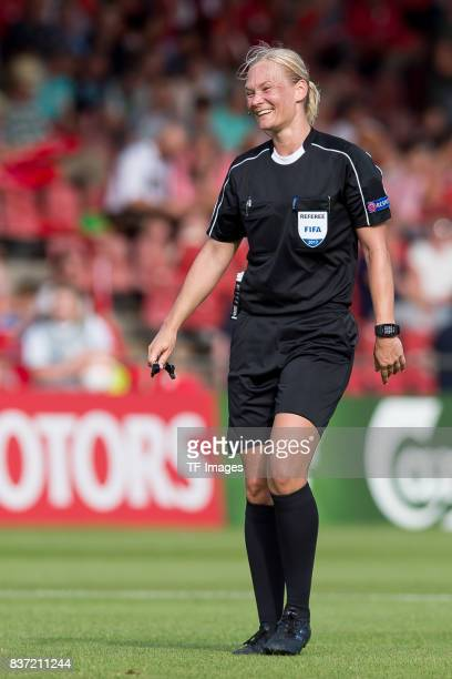 Referee Bibiana Steinhaus of Germany laughs during the Group C match between Austria and Switzerland during the UEFA Women's Euro 2017 at Stadion De...