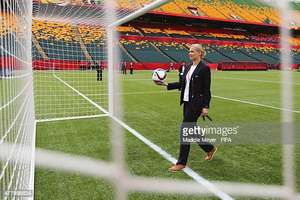 Referee Bibiana Steinhaus of Germany tests the goal detection technology before the FIFA Women's World Cup 2015 Round of 16 match between China PR...