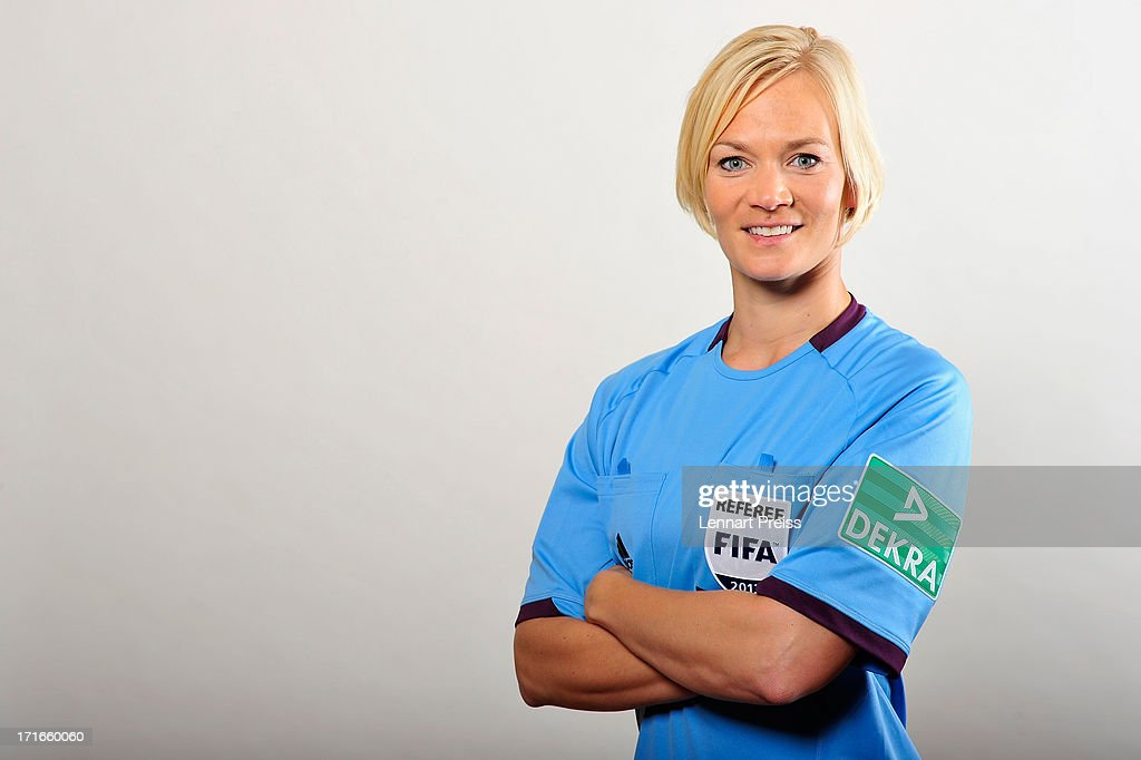 Referee <a gi-track='captionPersonalityLinkClicked' href=/galleries/search?phrase=Bibiana+Steinhaus&family=editorial&specificpeople=2299795 ng-click='$event.stopPropagation()'>Bibiana Steinhaus</a> poses during the DFB referee team presentation on June 27, 2013 in Grassau, Germany.