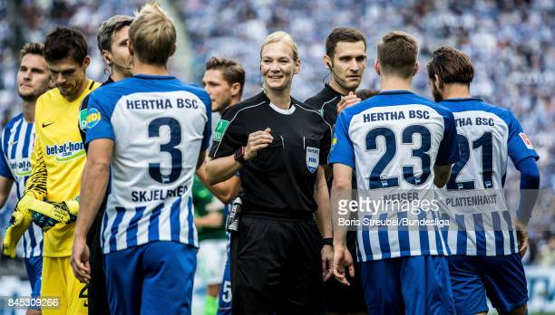 Referee Bibiana Steinhaus shake hands with players of Hertha BSC prior to the Bundesliga match between Hertha BSC and SV Werder Bremen at...